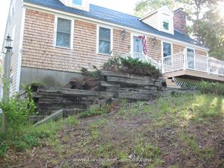 Timber retaining wall demolition and new  construction on Martha's Lane in Harwich.