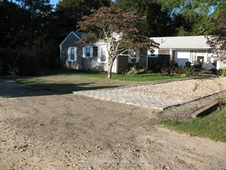 Cobblestone edging and apron with shell driveway