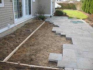 Bluestone patio reinstalled after foundation repair