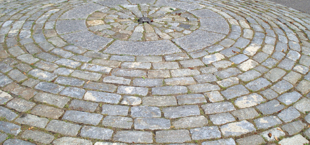 Cobblestones from reclaimed granite are exciting.