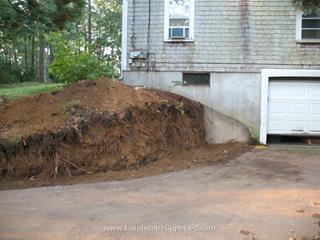 To build a timber retaining wall, begin by digging a trench along the line of where your wall will be. The trench should be approximately the depth and width of the timbers you will be using to build the wall. If you need space to work on the back side of the wall, dig that space out before you begin building the wall.