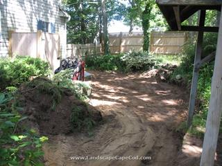 Backyard red brick patio construction