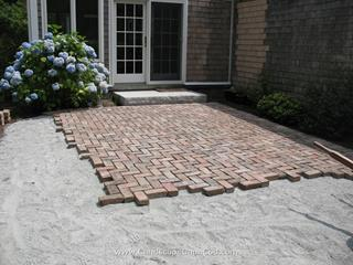 Brick patio construction.