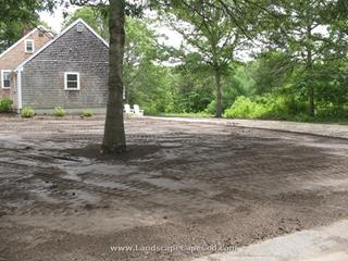New driveway, lawn renovation and replacement of old brick patio with a new Belgard paver patio installation.
